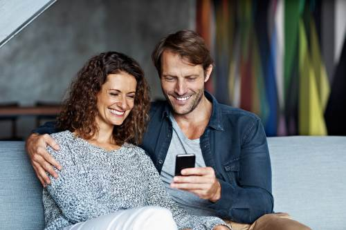 Couple using mobile banking
